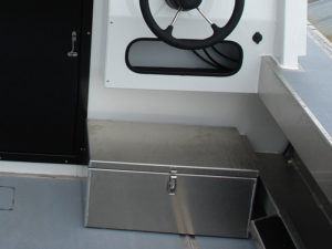 Storage box below aft helm (aluminum) for diesel tank.