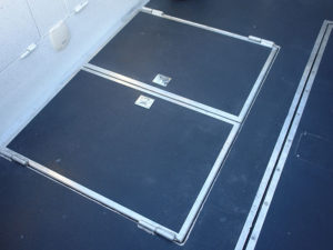 Storage-compartment-under-deck-with-baffle-(x2)