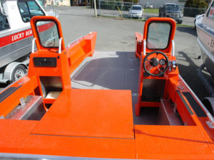 Dual consoles with windshield, storage and steering